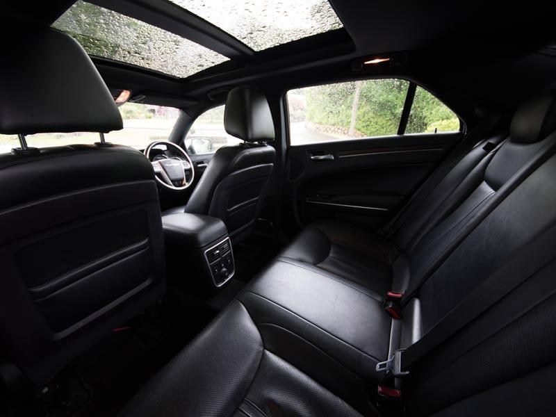 the interior of a black luxury chauffeur driven car